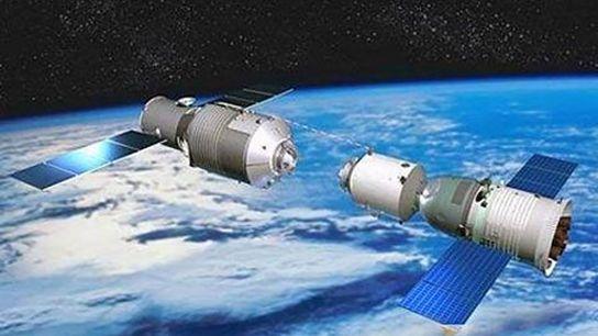 Una cápsula espacial tripulada se ensambló con la estación espacial Tiangong-1, en una ilustración publicada por ...