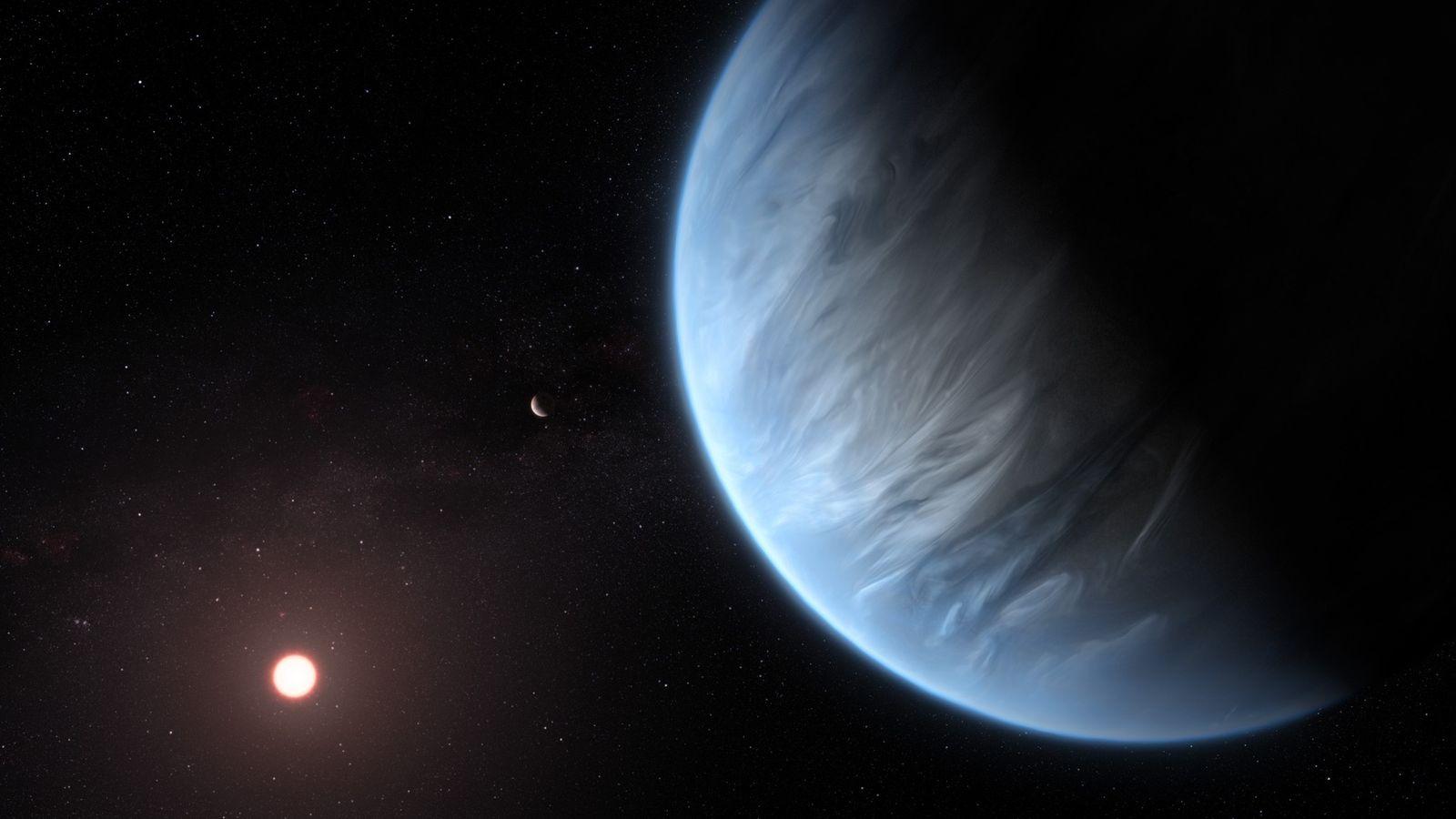 El planeta K2-18b orbita su tenue estrella anfitriona roja en una ilustración. Este exoplaneta es el ...