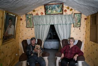 Manuel Gonzales and Encarna Sanchez pose for a portrait in their living room. Their cave was ...