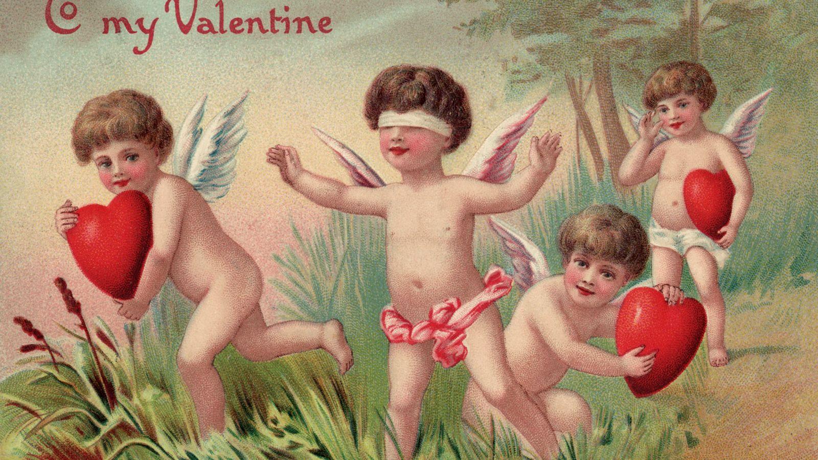 Una postal antigua del día de San Valentín. Cupido, el dios romano del amor y una ...