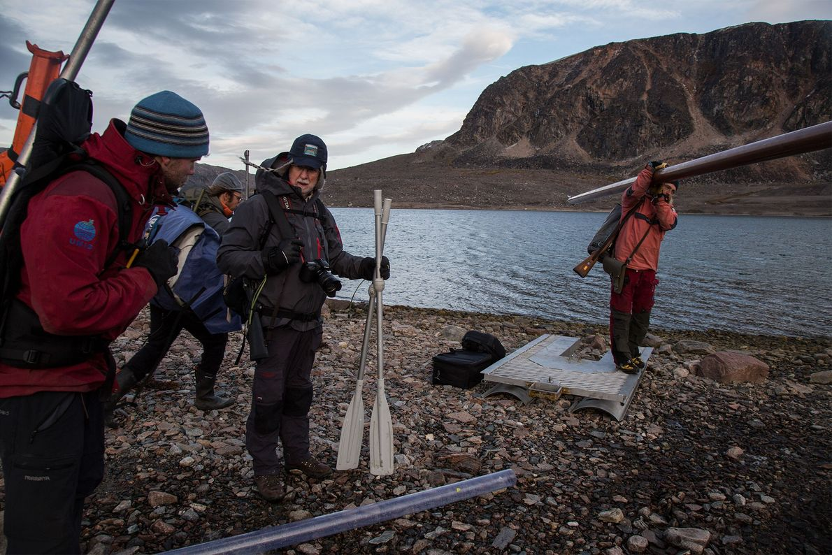 The team of scientists gathers all the equipment they can carry at Innvika Cove and carries ...
