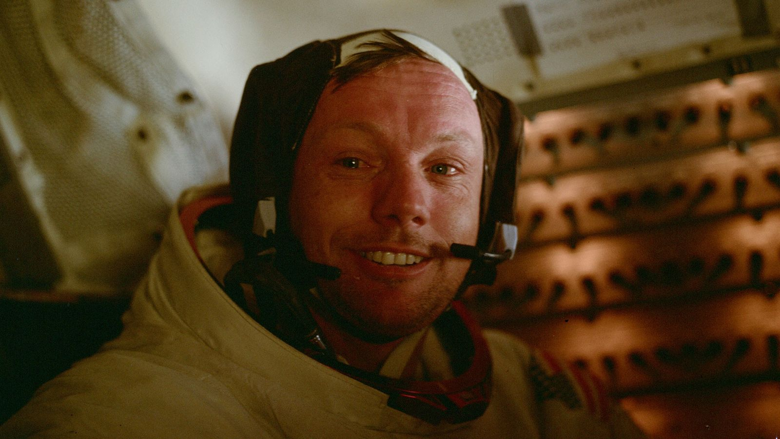 Apollo 11 astronaut Neil Armstrong in the lunar module shortly after taking the first steps on ...