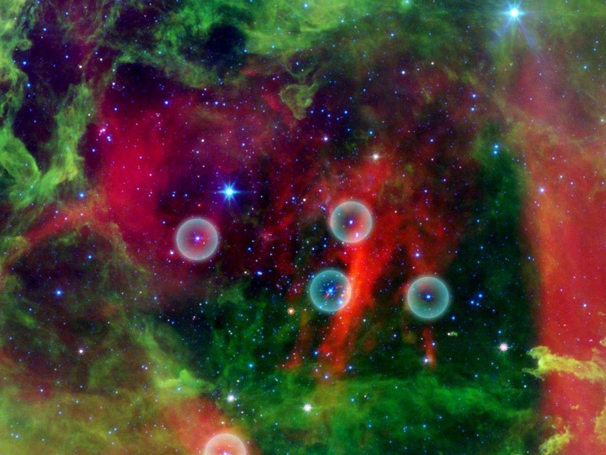 NEBULOSA ROSETA - La imagen infrarroja de la nebulosa Roseta muestra un grupo de estrellas O …