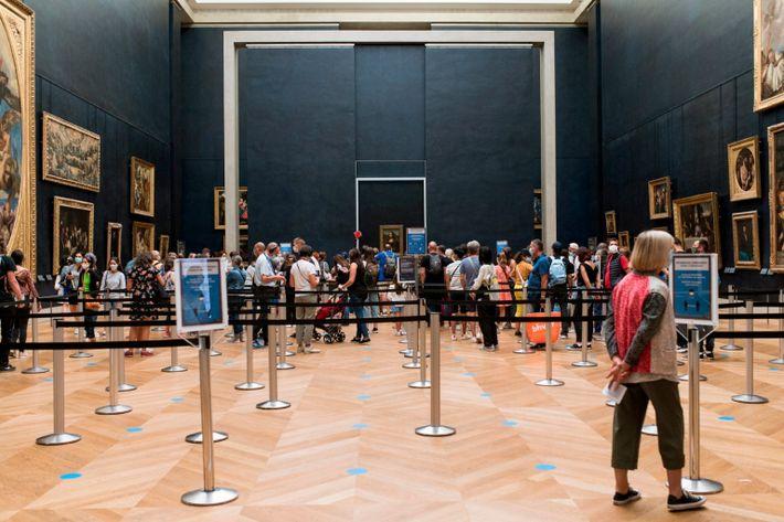 Tourists Visit The Louvre Museum - Paris