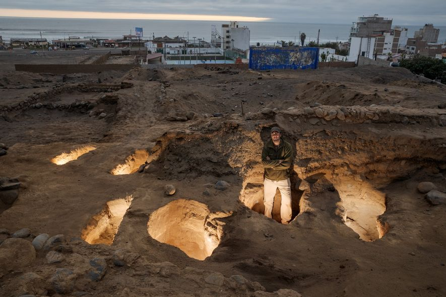 Archaeologist Prieto stands in one of six excavated burial pits atop the hill at the site ...
