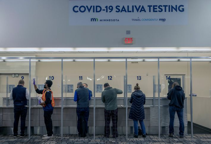 Travelers are tested for COVID-19 at the Minneapolis-St. Paul International Airport on November 12, 2020.