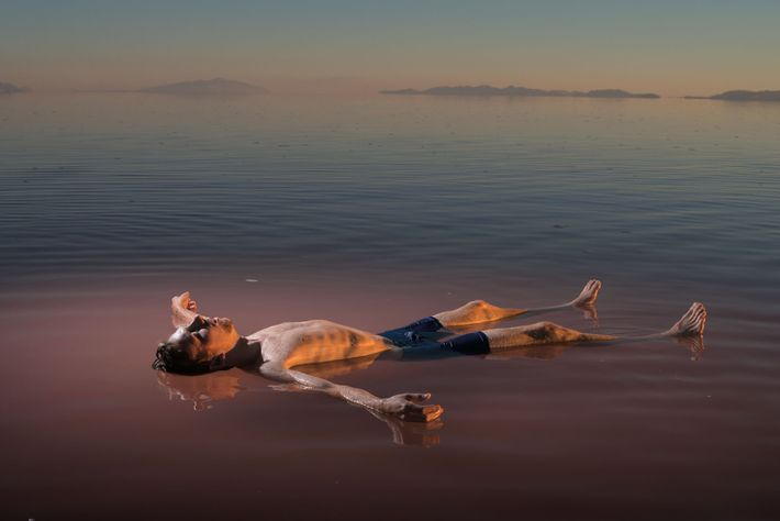 Benjamin Anderson floats on the north arm of Utah's Great Salt Lake. In the hypersaline water, ...