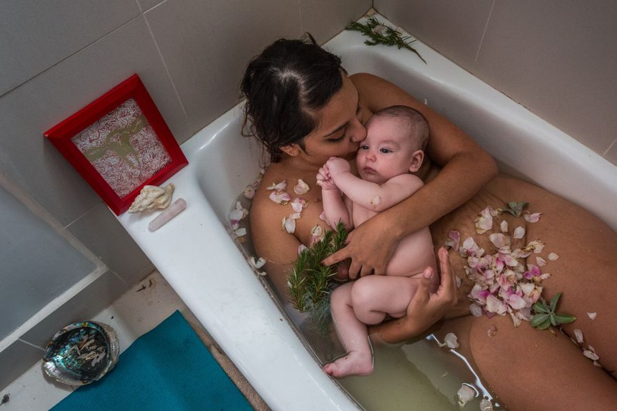 Laura Sermeño and her baby boy celebrate the end of her cuarentena, or quarantine. The tradition, ...