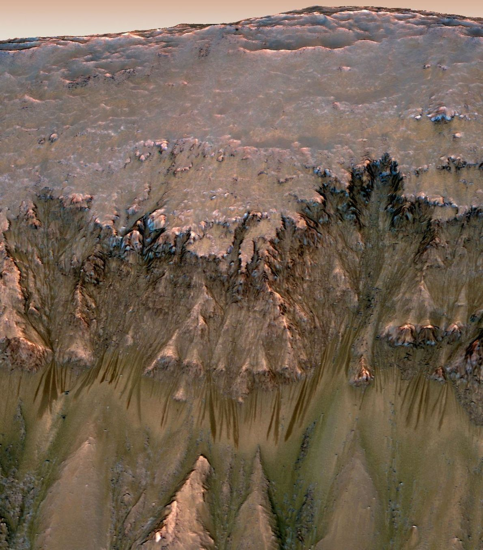 In 2015, scientists found dark streaks flowing down some Martian hillsides. Initially, salty liquid water was ...